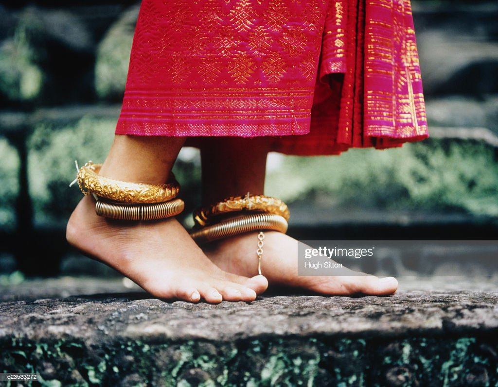 Young Buddhist Woman Wearing Gold Anklets : Stock Photo