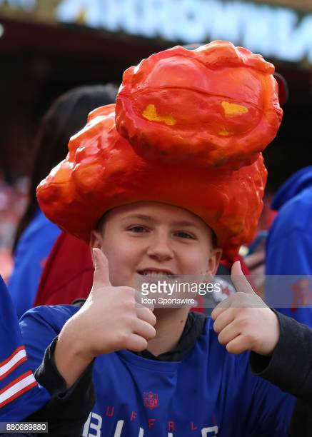 A young Buffalo fan wears a buffalo wing on his head before a week 12 NFL game between the Buffalo Bills and Kansas City Chiefs on November 26 2017...