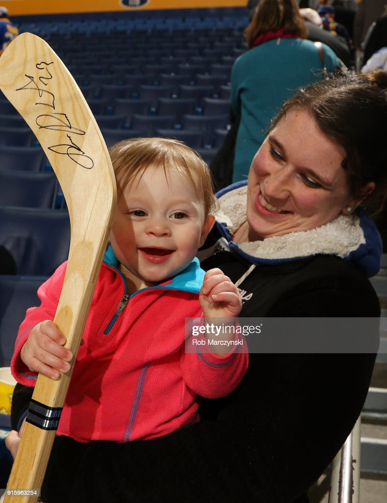 A young Buffalo Sabres fan smiles after receiving a souvenir hockey stick from Sam Reinhart (not shown) following their 4-3 victory against the New York Islanders in an NHL game on February 8, 2018 at KeyBank Center in Buffalo, New York.