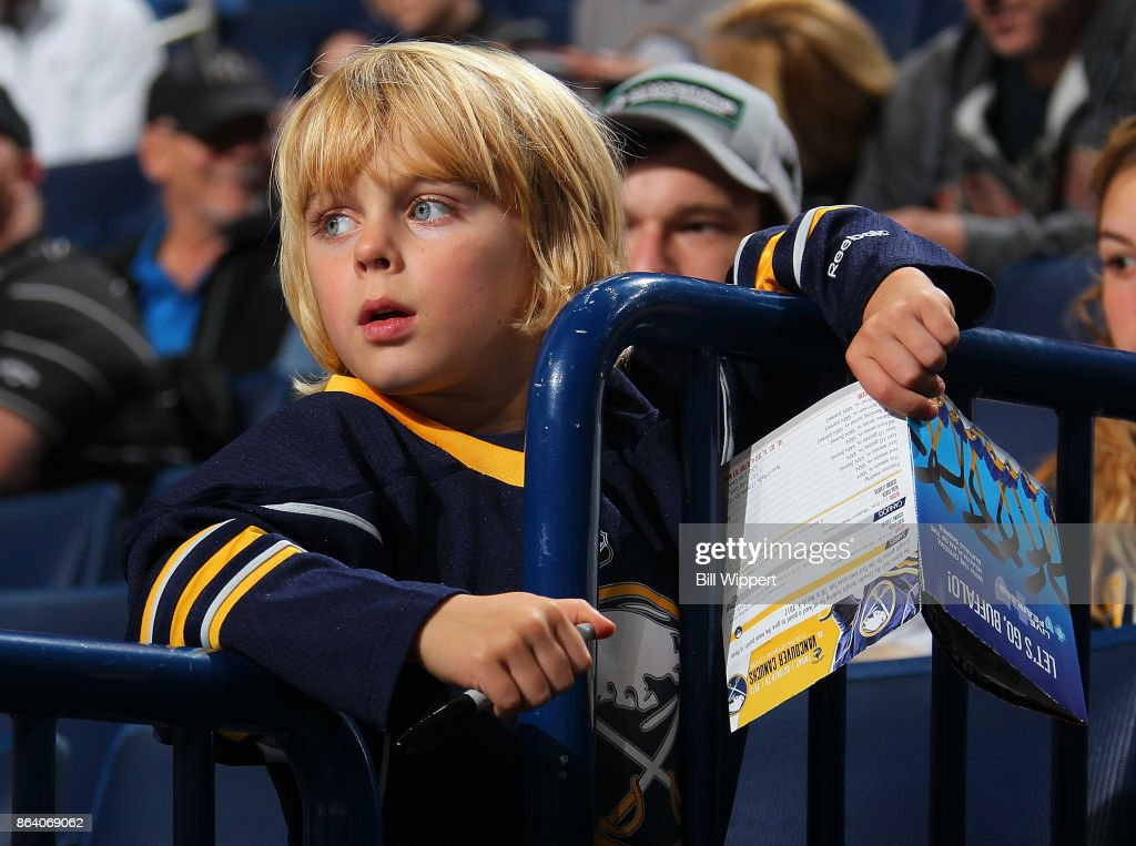 A young Buffalo Sabres fan watches warmups before an NHL game against the Vancouver Canucks on October 20, 2017 at KeyBank Center in Buffalo, New York.