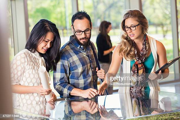 Young buisnesswoman leading meeting with creative team modern office