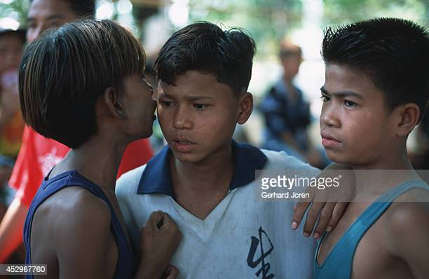 Young Burmese boxers discuss the upcoming bouts taking place in Mae Kon Ken village close to the ThaiBurmese border It's the promoter's job to match...