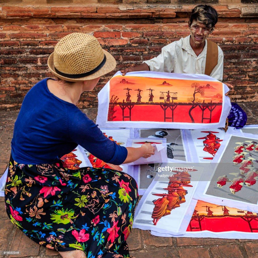 Young Burmese Boy Selling Sand Paintings In Bagan Myanmar
