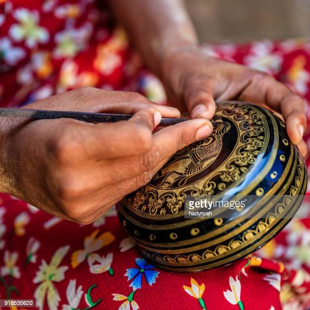 young burmese girl making a lacquerware in bagan, myanmar - myanmar stock pictures, royalty-free photos & images