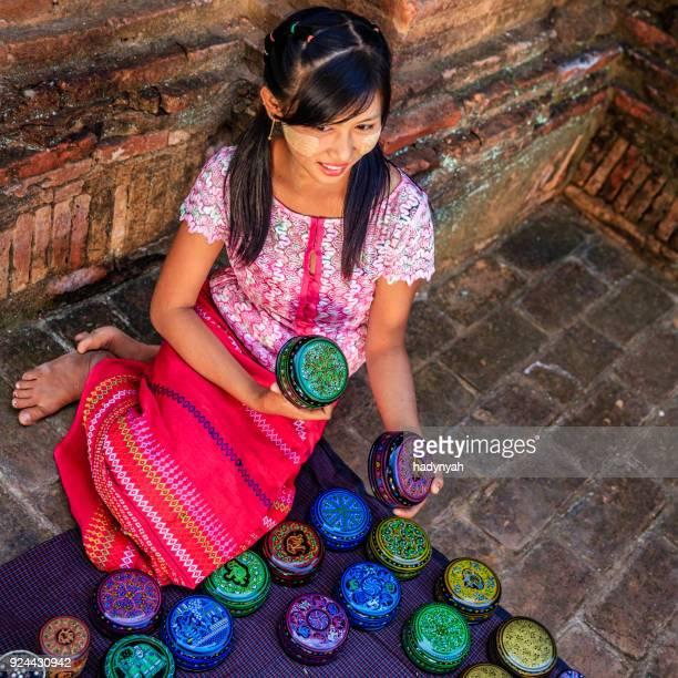 Young Burmese girl selling a lacquerware in Bagan, Myanmar