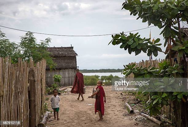 A young Burmese monk walks through his village near the planned Dawei SEZ on August 3 2015 in Pantininn Myanmar The controversial multibillion dollar...