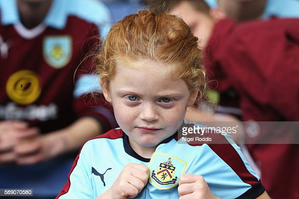 A young Burnley fan enjoys the pre match atmospehere during the Premier League match between Burnley and Swansea City at Turf Moor on August 13 2016...