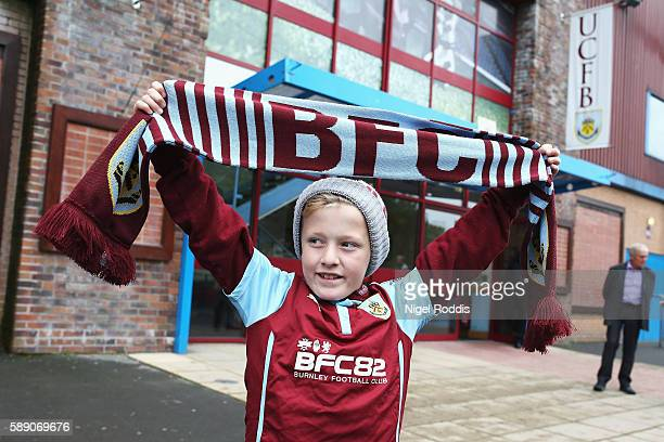A young Burnley fan enjoys the pre match atmosperhe prior to kick off during the Premier League match between Burnley and Swansea City at Turf Moor...