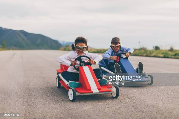 young business boy and girl race cars - racing car stock pictures, royalty-free photos & images