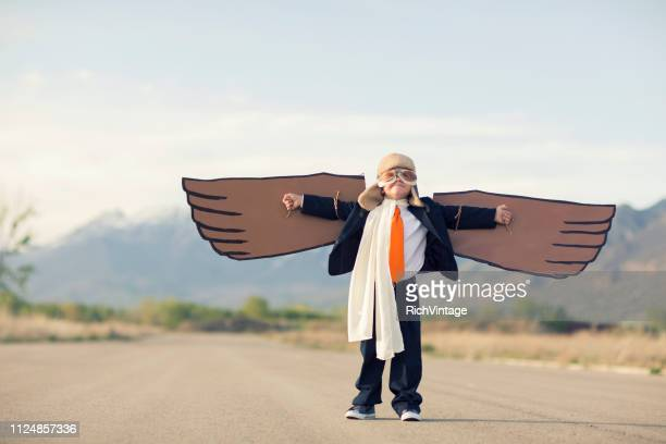 young business boy and pilot with cardboard wings - adult imitation stock pictures, royalty-free photos & images