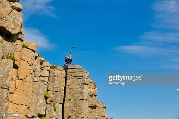 Young Business Boy at the Edge with Telescope