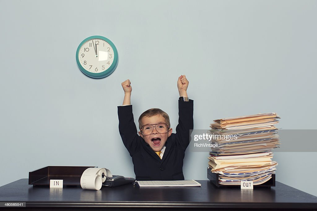 Young Business Boy Celebrates with Work Finished : Stock Photo