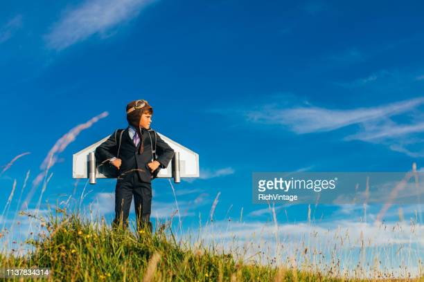 young business boy entrepreneur wearing jetpack - strategy stock pictures, royalty-free photos & images