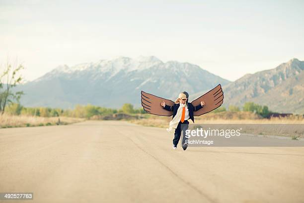 Young Business Boy Flying with Cardboard Wings