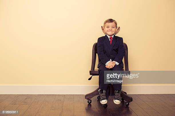 Young Business Boy on Chair Wearing Big Ears