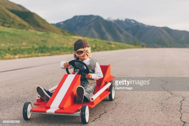 Young Business Boy Racing a Go Cart