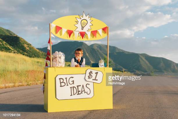 Young Business Boy Runs Big Idea Stand