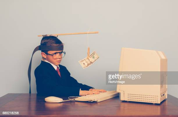 young business boy uses motivation at work - incentive stock photos and pictures