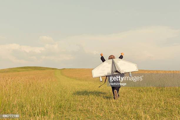 young business boy wearing jetpack in england - inspiratie stockfoto's en -beelden