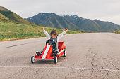 Young Business Boy Wins Go Cart Race