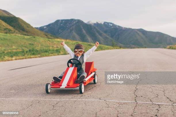 young business boy wins go cart race - achievement stock pictures, royalty-free photos & images