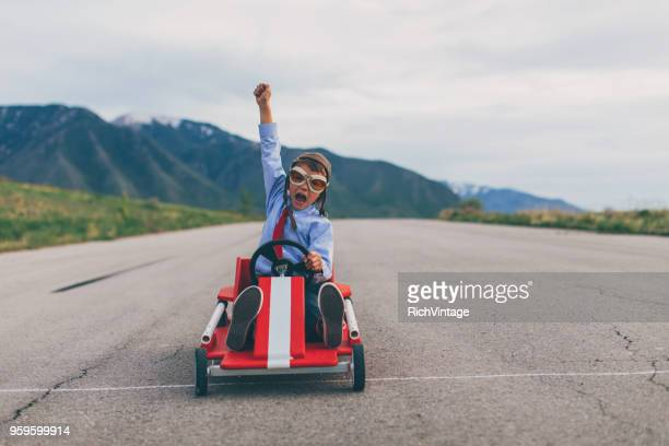 young business boy wins go cart race - endurance stock photos and pictures