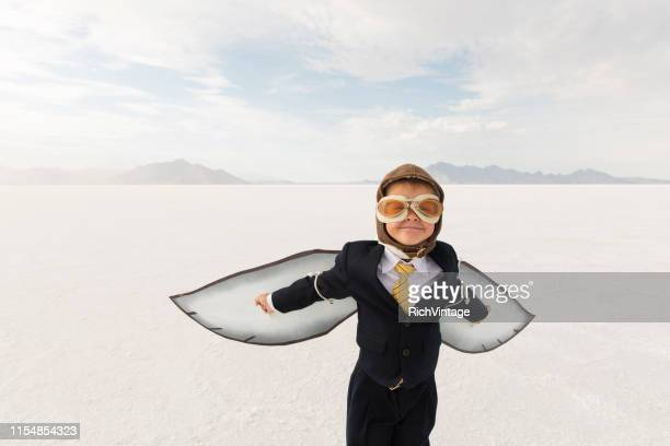 young business boy with cardboard wings - adult imitation stock pictures, royalty-free photos & images
