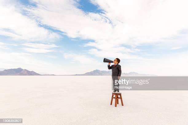 young business boy with megaphone - adult imitation stock pictures, royalty-free photos & images