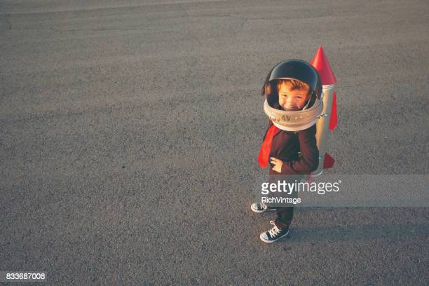 young business boy with rocket on back - kick off stock pictures, royalty-free photos & images