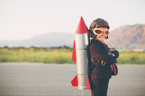 Young Business Boy with Rocket on Back - gettyimageskorea