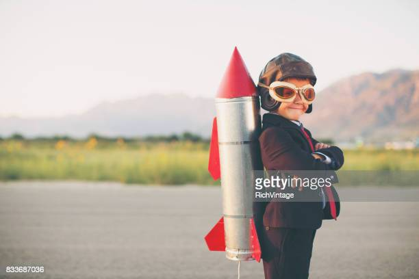 young business boy with rocket on back - festa per il lancio pubblicitario foto e immagini stock