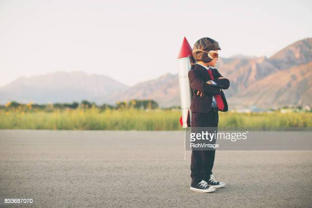 young business boy with rocket on back - action plan stock photos and pictures