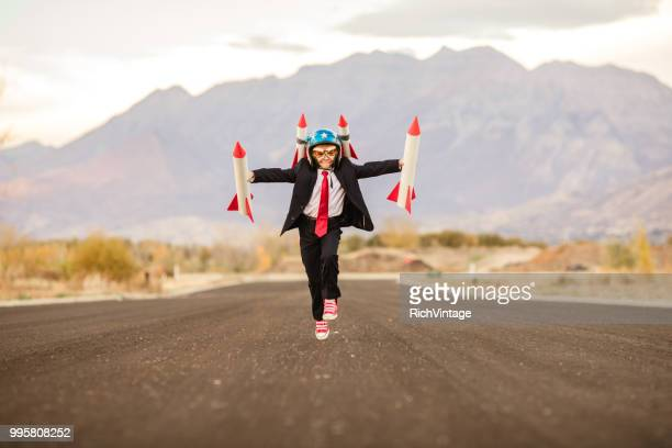 young business boy with rockets - rocket stock pictures, royalty-free photos & images