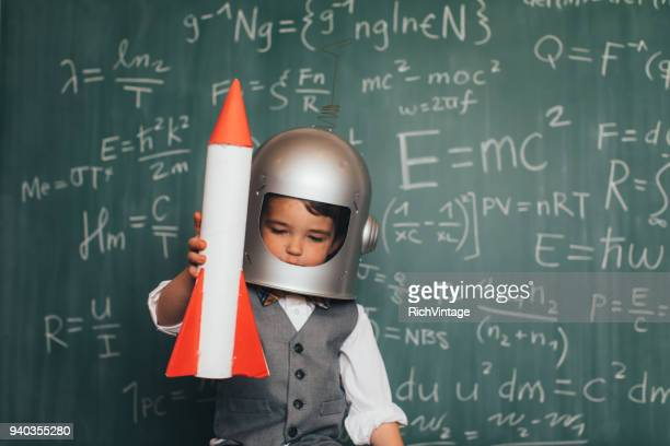 young business boy with space helmet and rocket - festa per il lancio pubblicitario foto e immagini stock