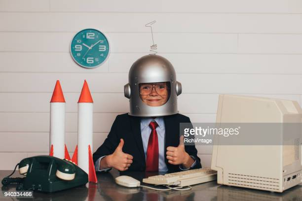 young business boy with space helmet and rockets - festa per il lancio pubblicitario foto e immagini stock