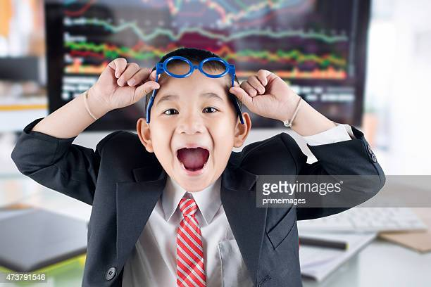 Young business boy with stock market office