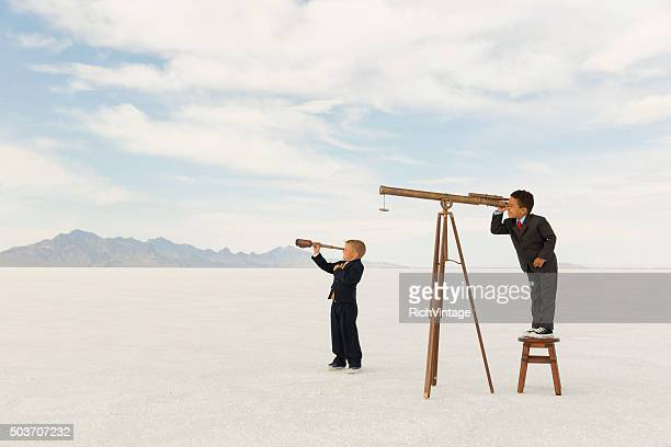 Young Business Boys Looking Through Telescopes
