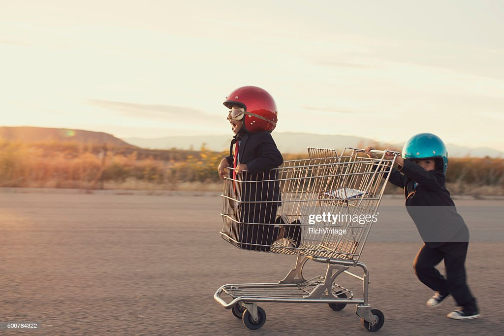 Young Business Boys Race in Shopping Cart : Stock Photo