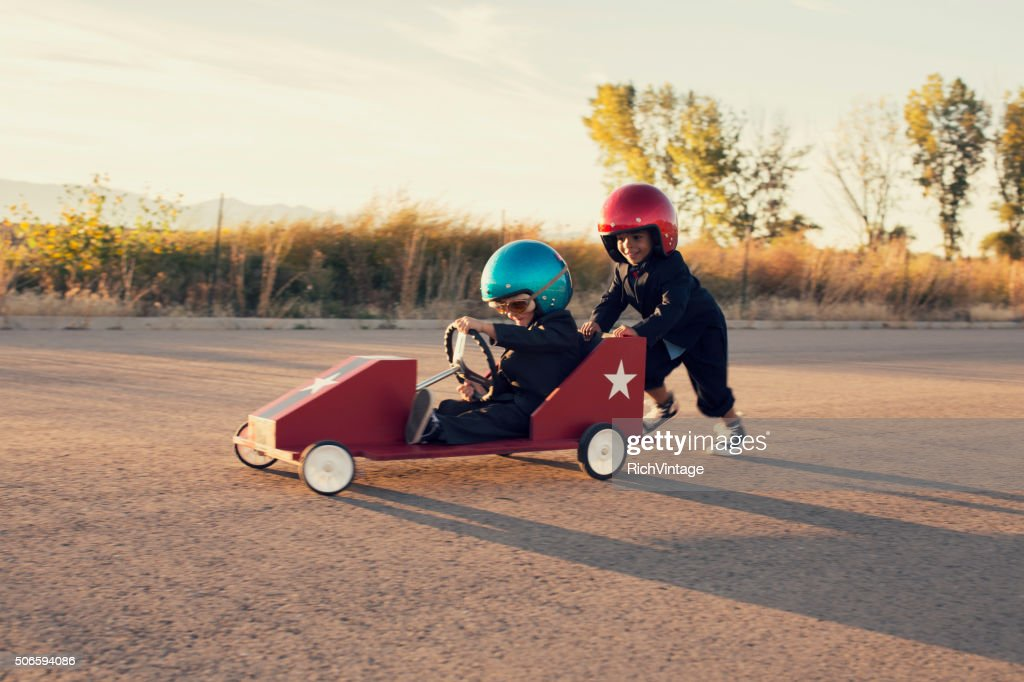 Young Business Boys Race Toy Car : Stock Photo