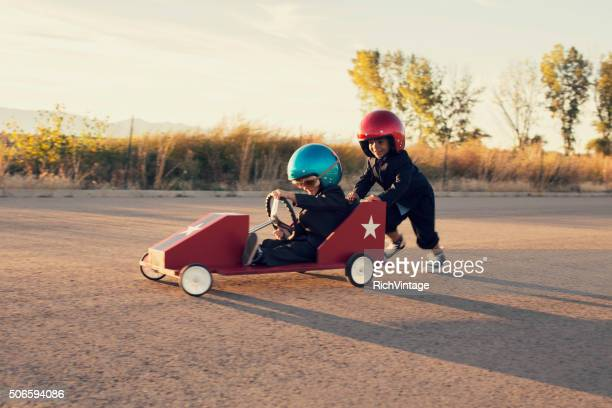 young business boys race toy car - sportkleding stock pictures, royalty-free photos & images