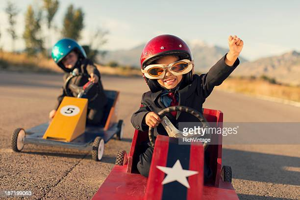 young business boys race toy cars - kindertijd stockfoto's en -beelden