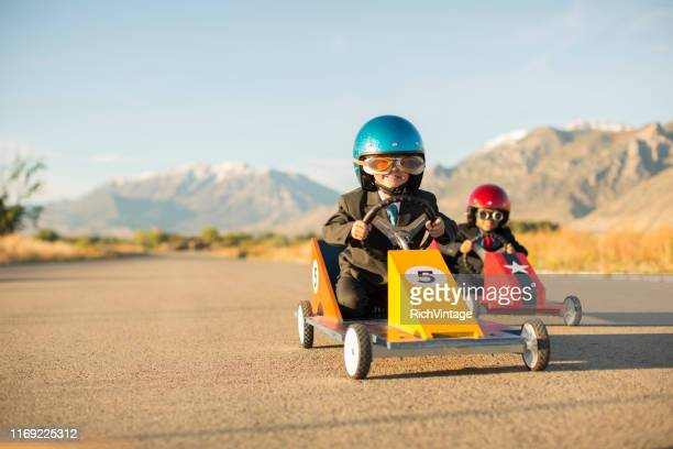 young business boys racing toy cars - auto racing photos stock pictures, royalty-free photos & images