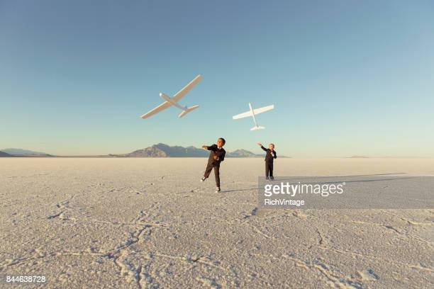 Young Business Boys Throw Toy Airplanes