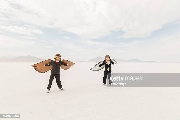 Young Business Boys Wearing Cardboard Wings