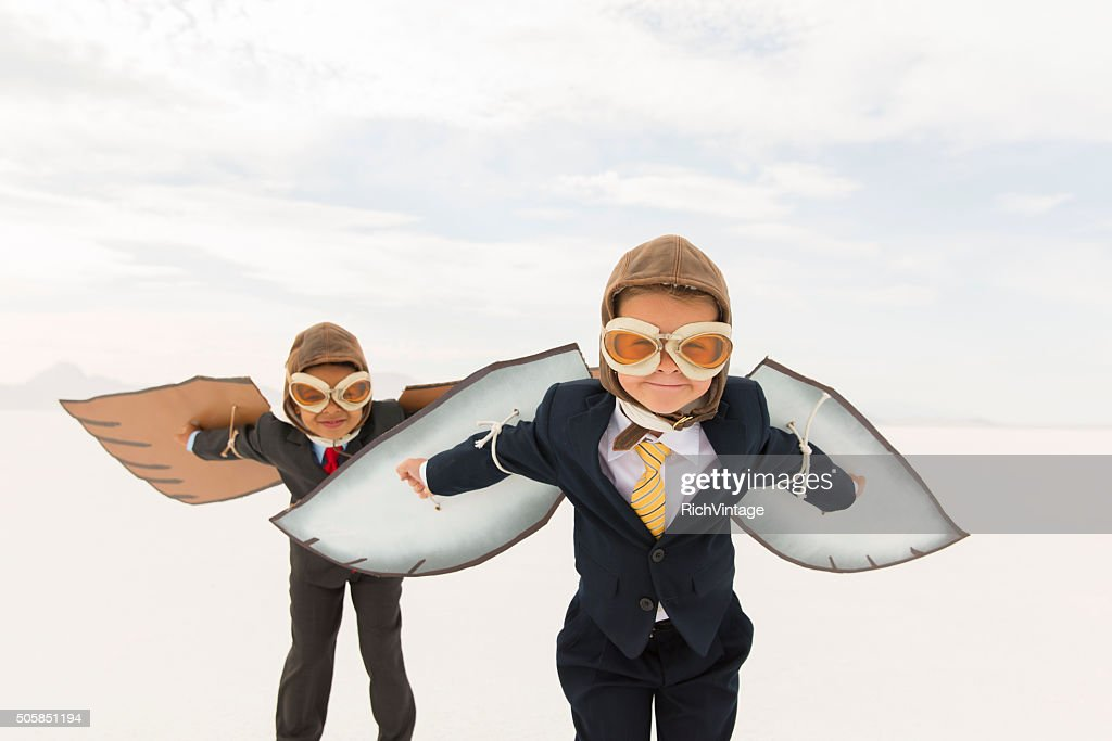 Young Business Boys Wearing Cardboard Wings : Stock Photo