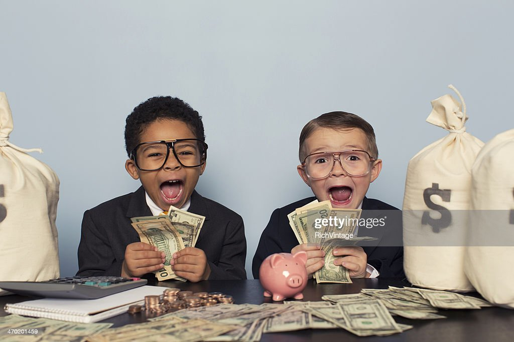 Young Business Children Make Faces Holding Lots of Money : Stock Photo