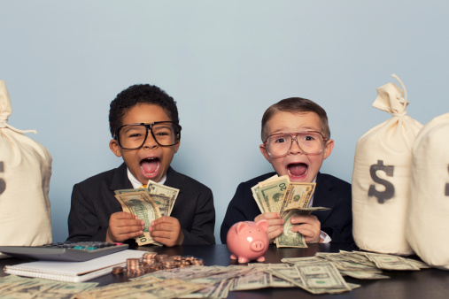 Young Business Children Make Faces Holding Lots of Money 470201459