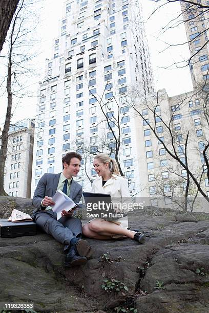 Young business couple in Central Park.