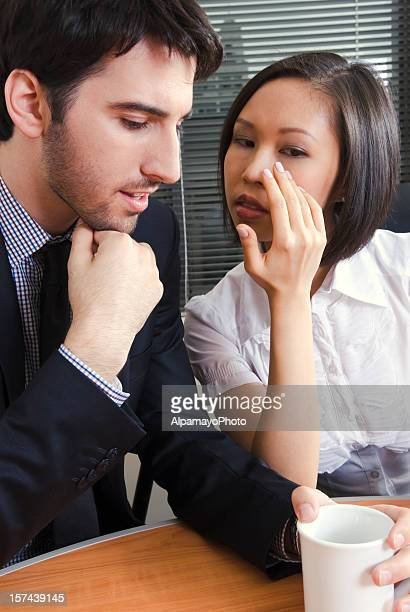 Young business co-workers are gossiping - II