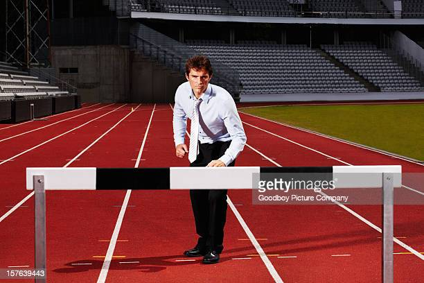 Young business executive getting ready for hurdle race
